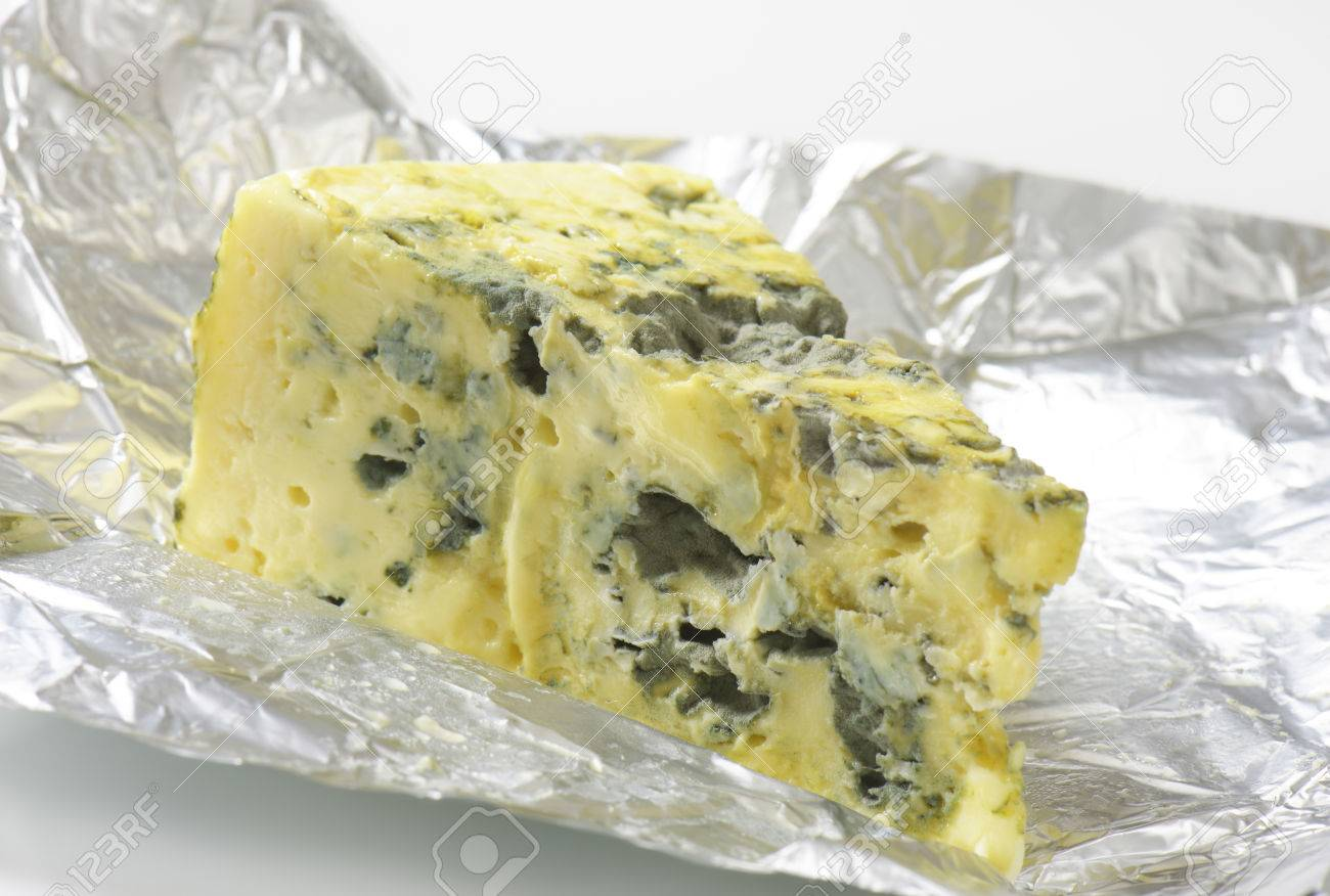 wedge of french blue cheese on foil stock photo picture and royalty