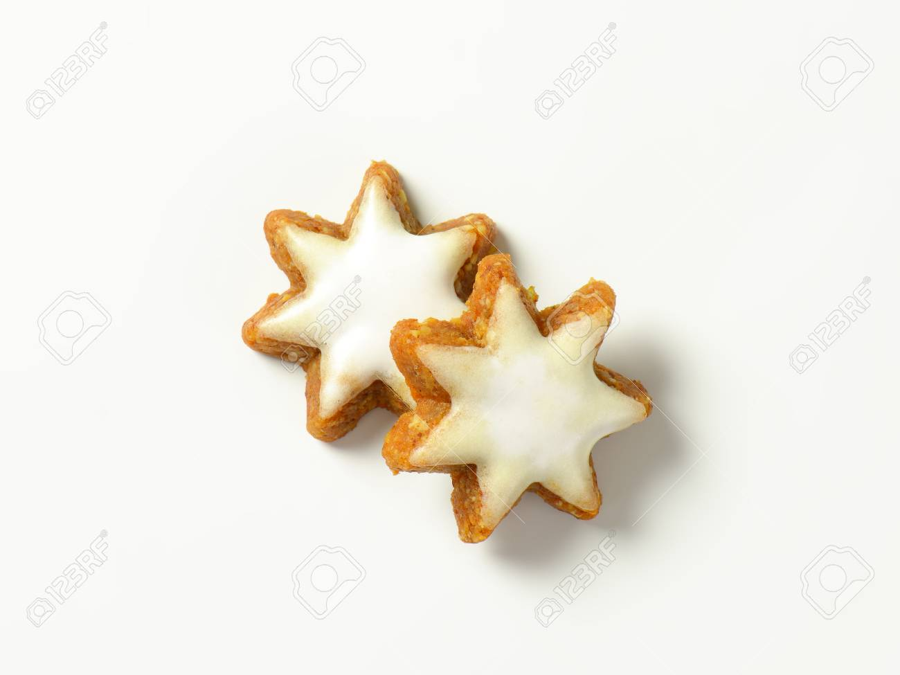 Two Christmas Star Cookies On White Background