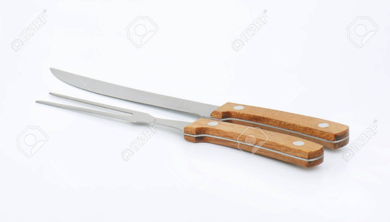 Wood handled carving knife and fork set stock photo picture and