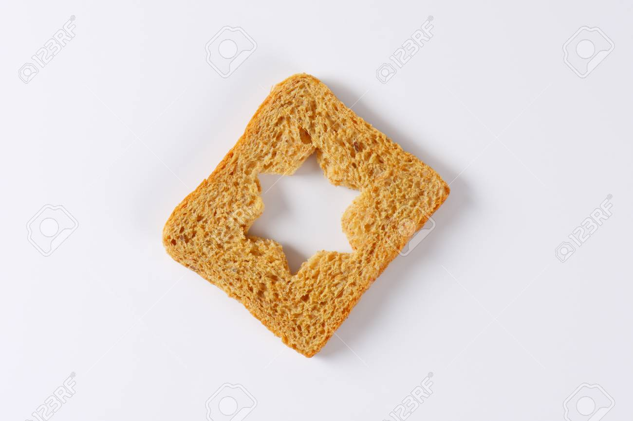 Slice Of Bread With Cut Out Star Shape Stock Photo