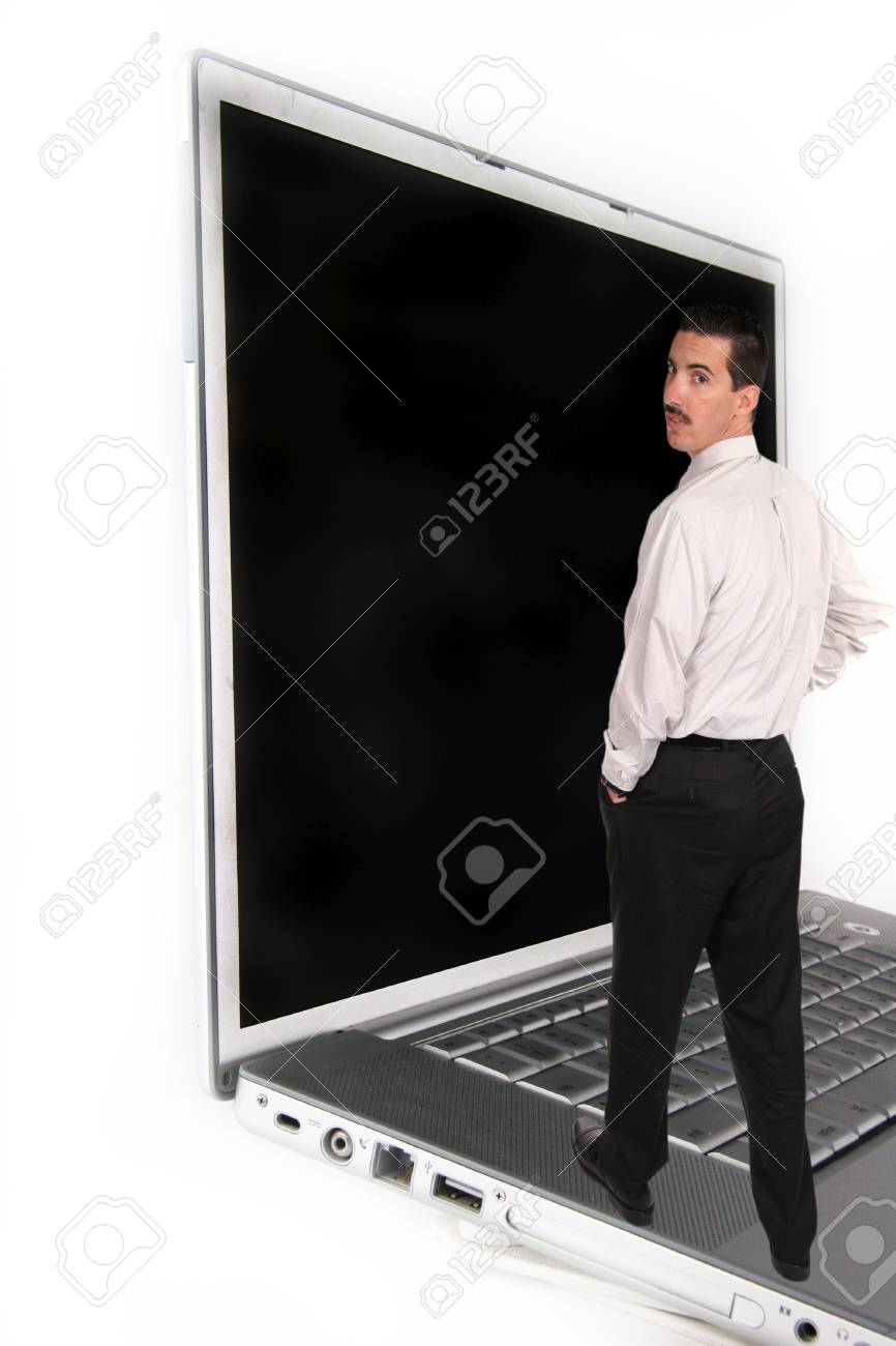 Business Man Standing on Laptop Computer Stock Photo - 297049