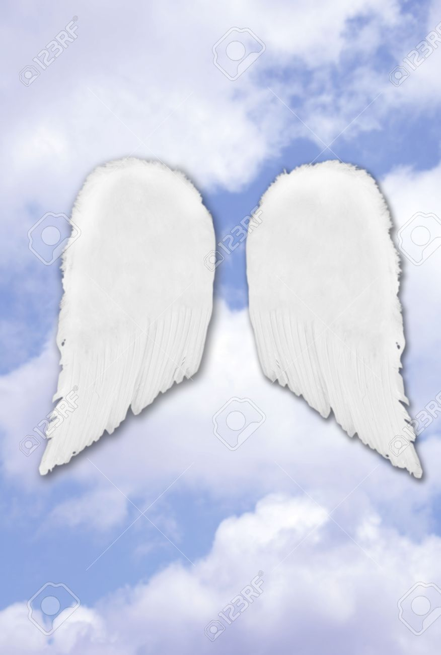Isolated Separated Angel Wings On Fantasy Heavenly Sky Stock Photo