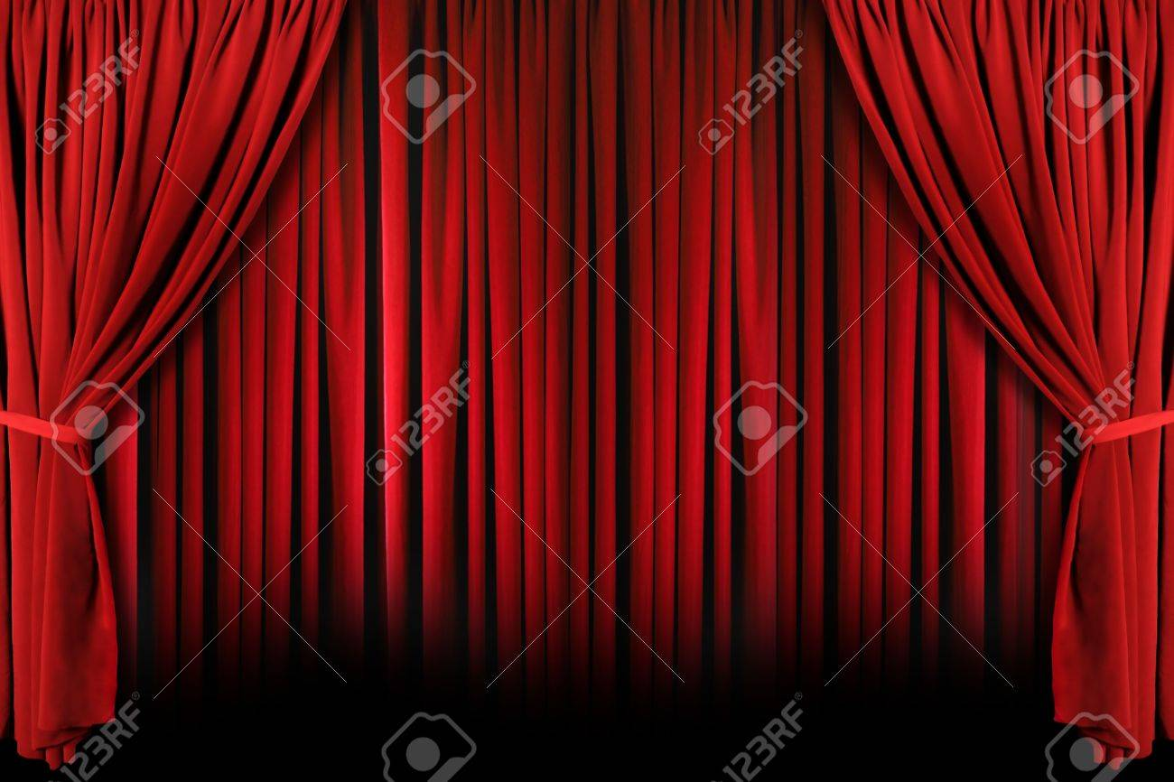 Red Draped Theater Stage Curtains With Light And Shadows Stock Photo