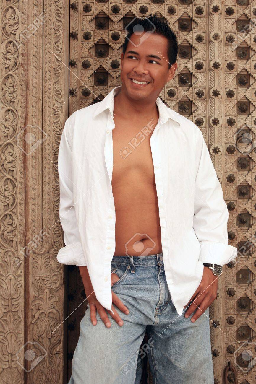 Smiling Happy Asian Male With White Shirt Open And Chest Exposed ...