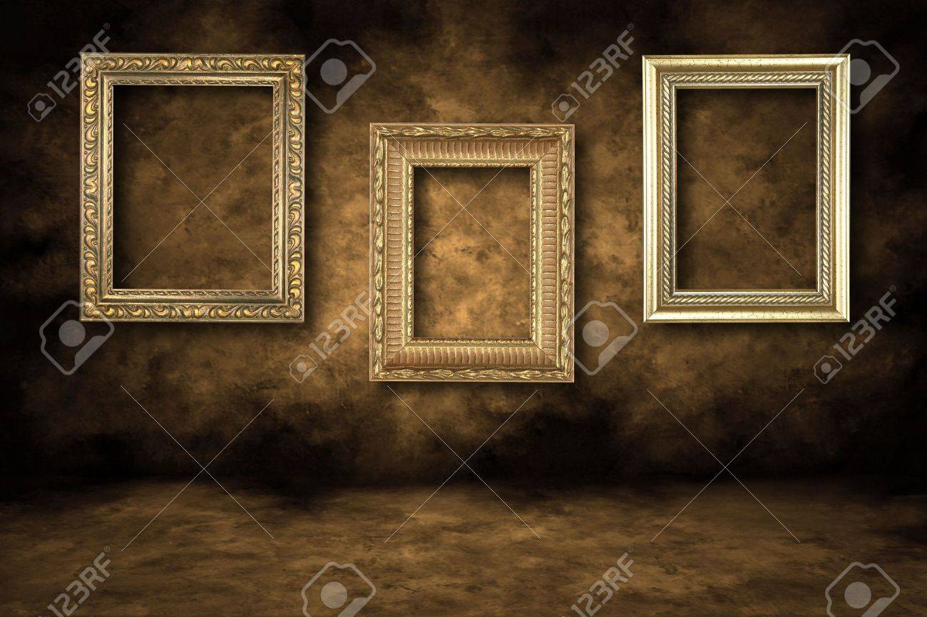 Three Guilded Picture Frames Hanging On A Grungy Wall Stock Photo ...