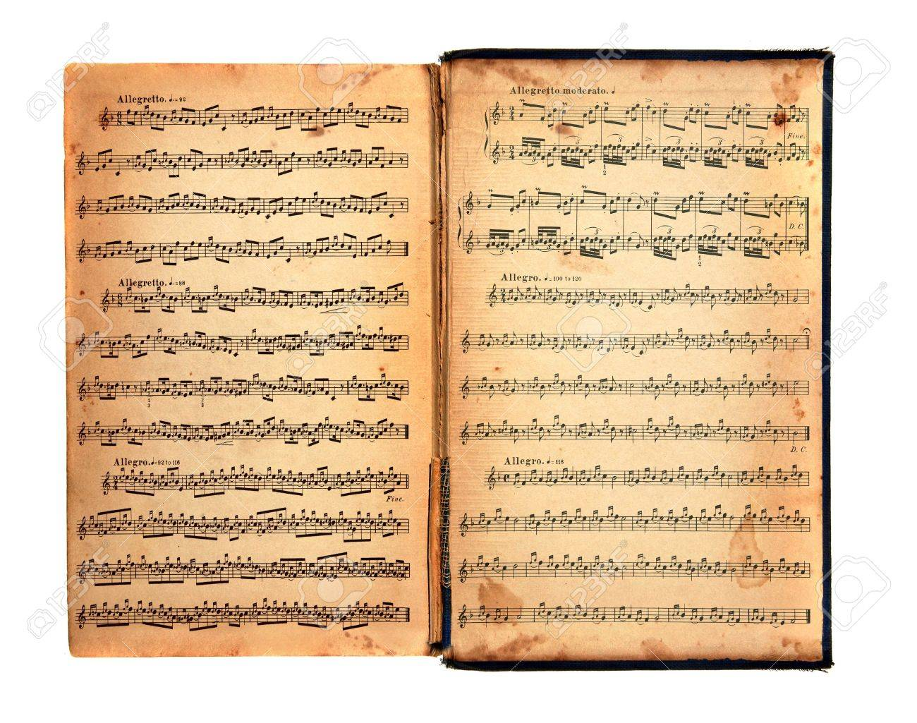 worn tattered distressed vintage book with music printed on the pages stock photo 3544382