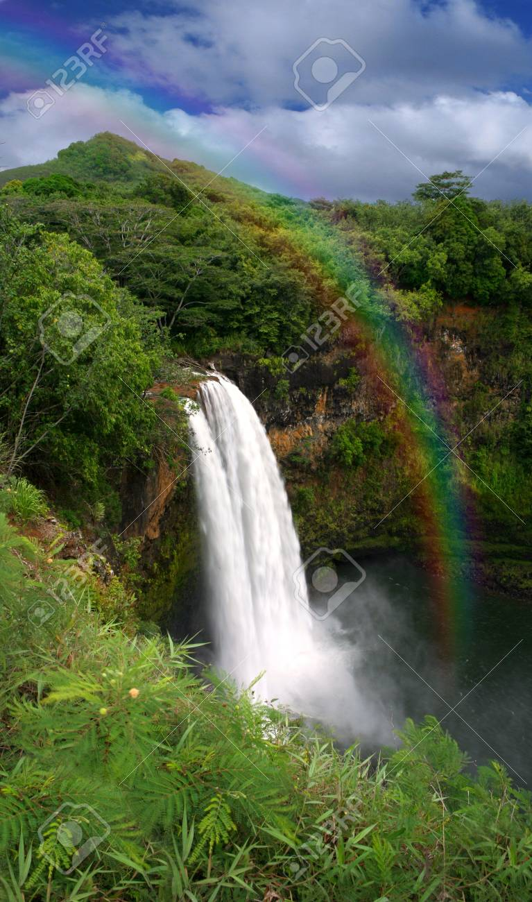 Waterfall in Hawaii With a Colorful Fantastic Rainbow Stock Photo - 3947384