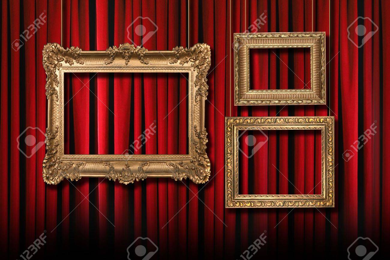 Red Stage Theater Curtains With 3 Hanging Gold Frames Stock Photo