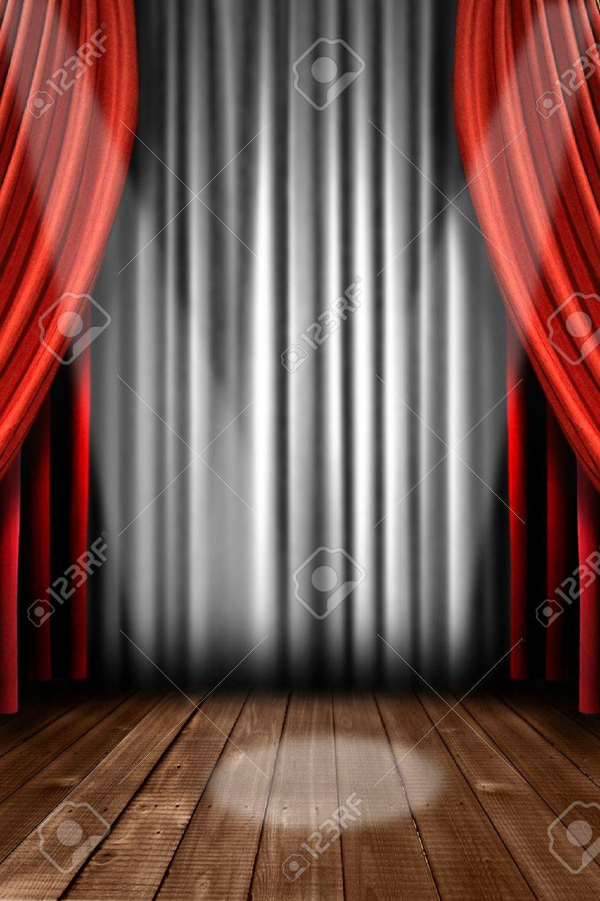 Stage curtains spotlight - Vertical Stage Drapes With Dramatic Spotlight In The Center Stock Photo 4328802
