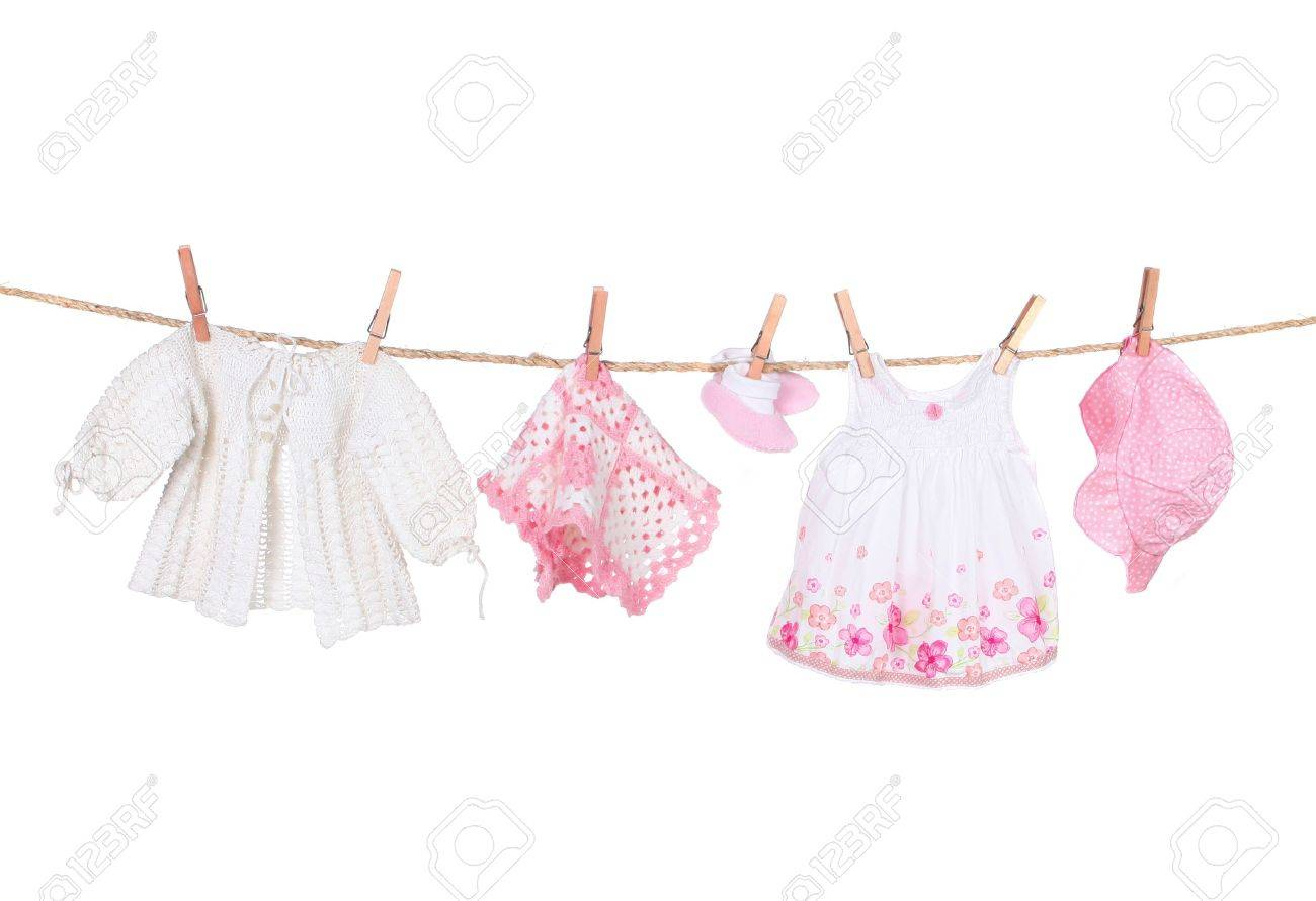 Baby Girl Clothing Hanging on a Clothesline Isolated on White..