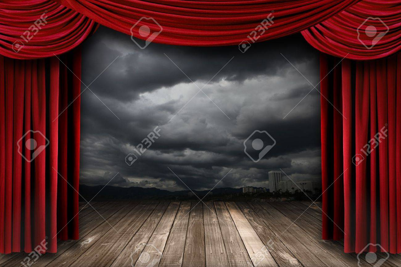 Bright Stage With Red Velvet Theater Curtains And Dramatic Sky Background Stock Photo