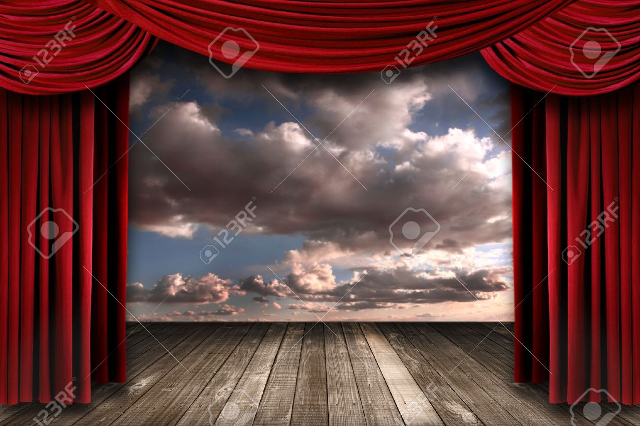 Beautiful Stage With Red Velvet Theater Curtains And Dramatic Sky Background Stock Photo