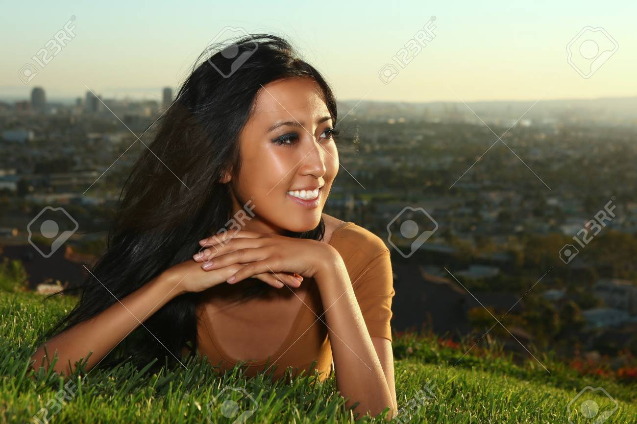 Beautiful Asian Woman Outdoors at Sunset Stock Photo - 11227327
