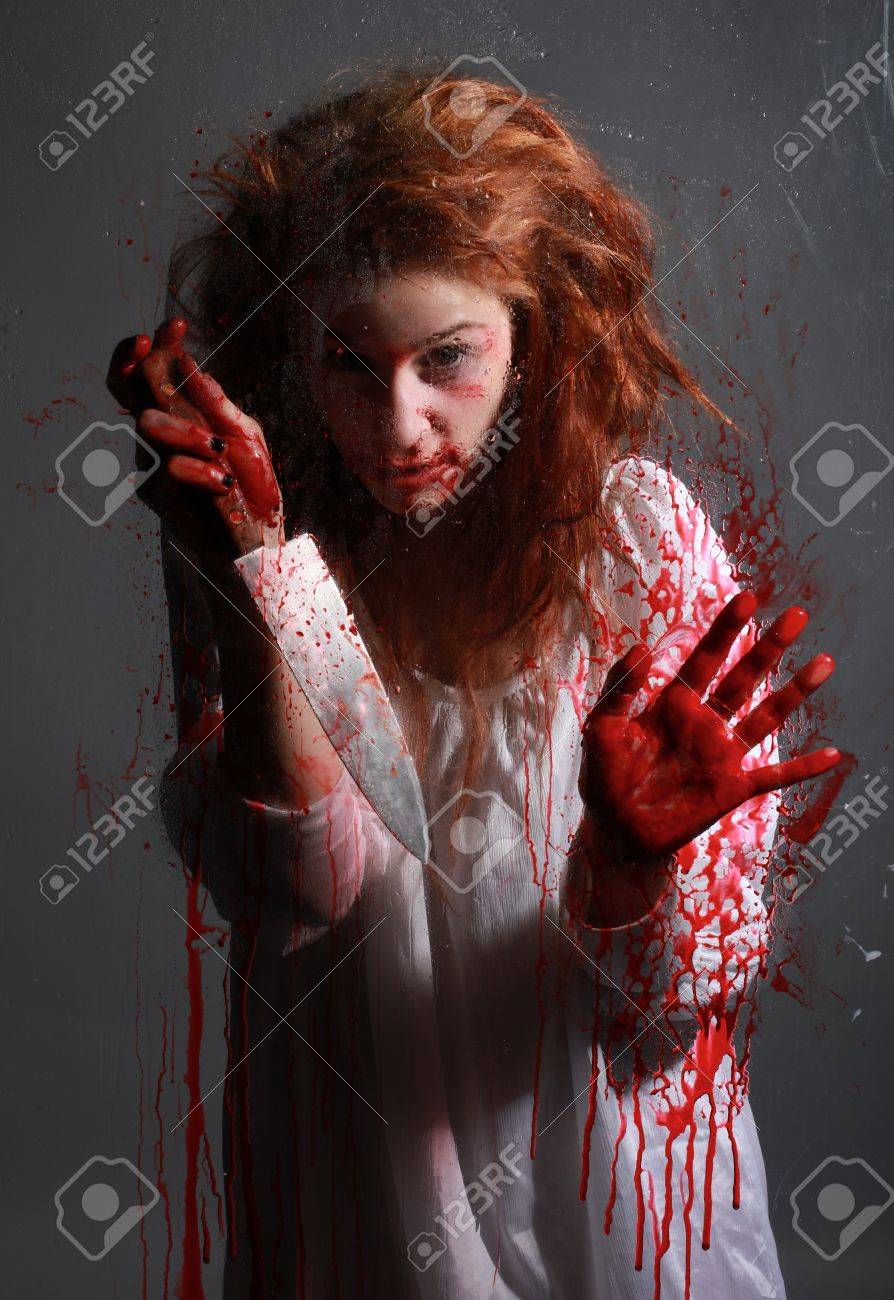 Woman in Horror Situation With Bloody Face Stock Photo - 13100104