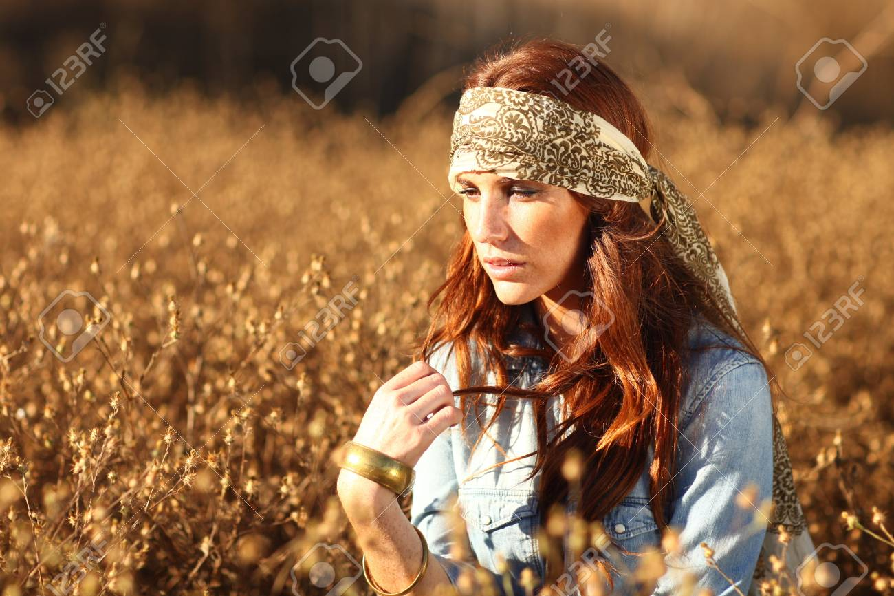Young Beautiful Woman in a Field During Summertime Stock Photo - 15154305