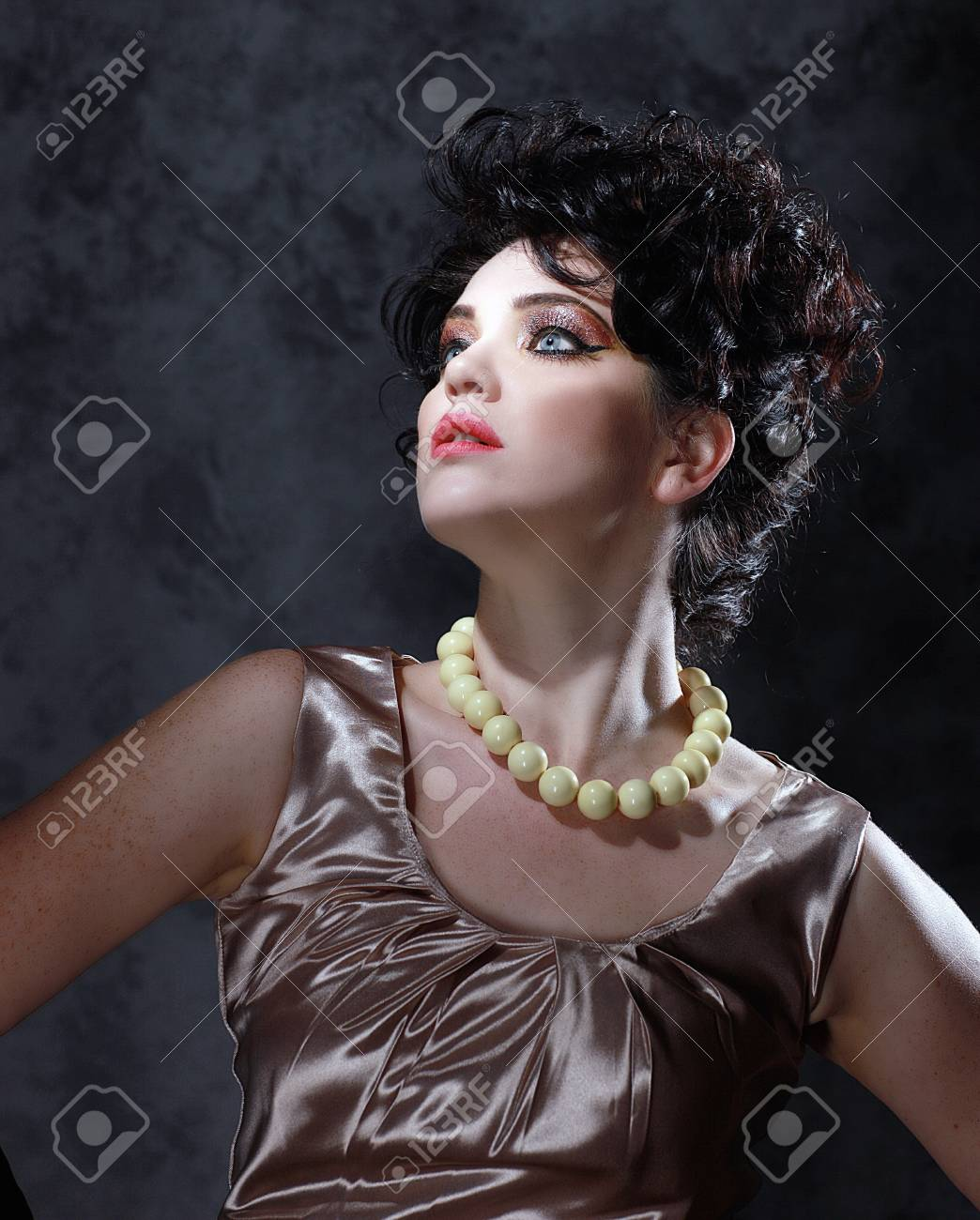 Stunning High Fashion Woman With Piercing Eyes Stock Photo - 15154317