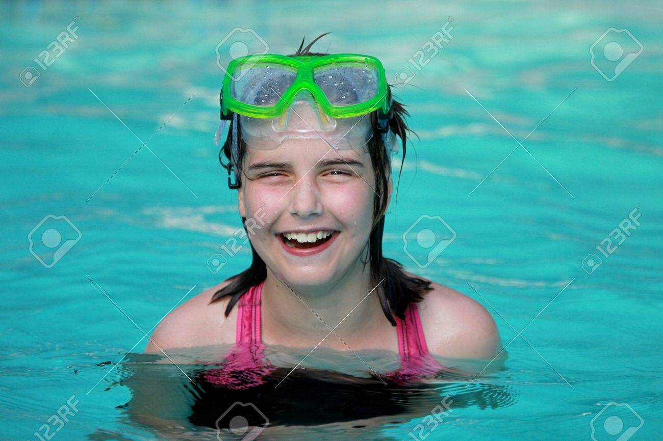 Young Girl Child in a Swimming Pool Stock Photo - 16796696