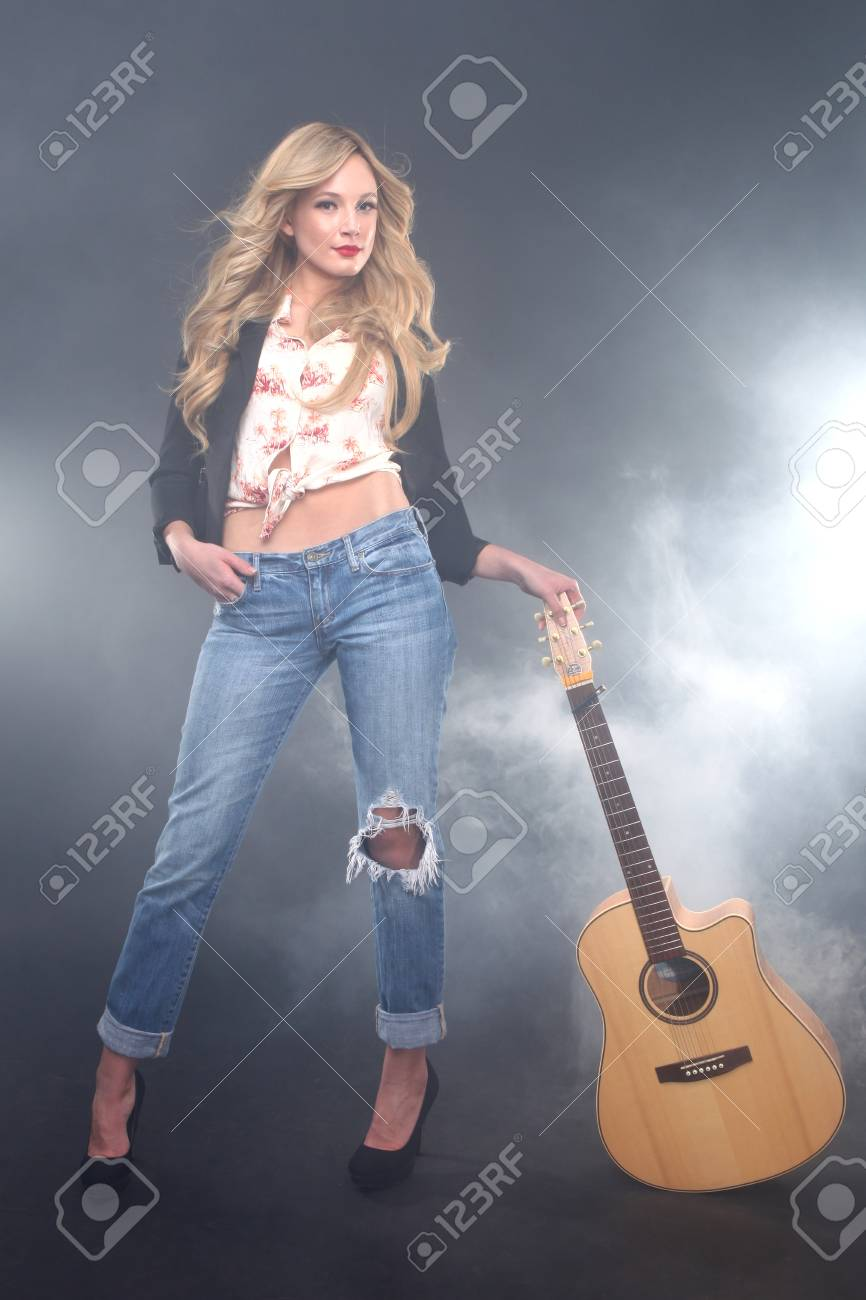 Blonde Rock Star on Stage Singing and Performing Stock Photo - 17457785