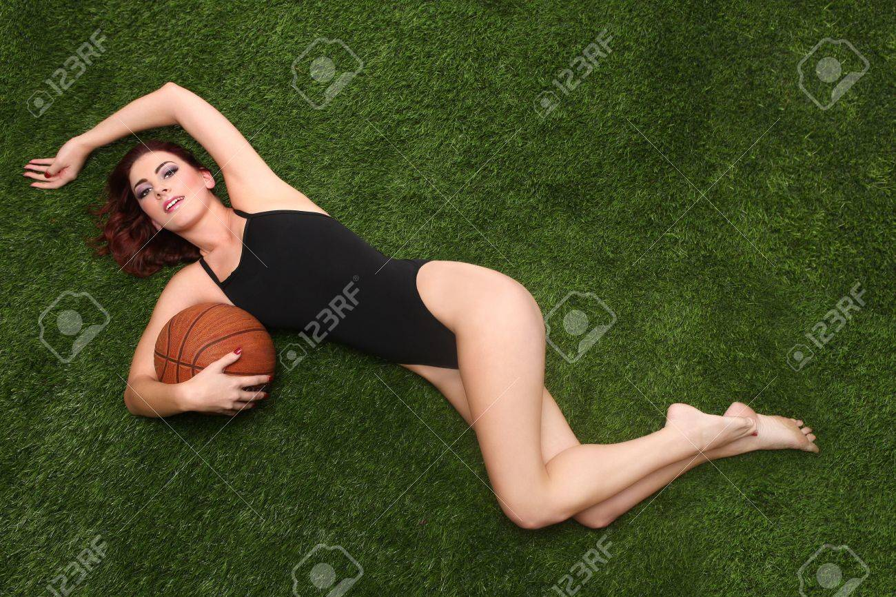 Beautiful Young Woman Holding a Basketball Stock Photo - 17439684