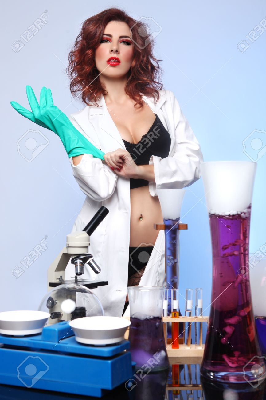 Exaggerated Science Student in Sexy Clothing Experimenting Stock Photo - 17827519