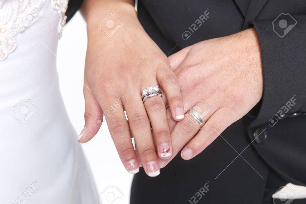Hand Of A Married Couple With Wedding Rings And Bands Stock Photo ...