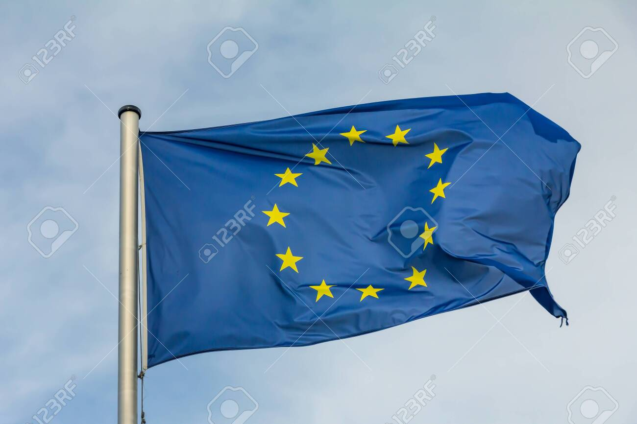 EU, Europe, European Union flag waving on blue sky background - 142111062