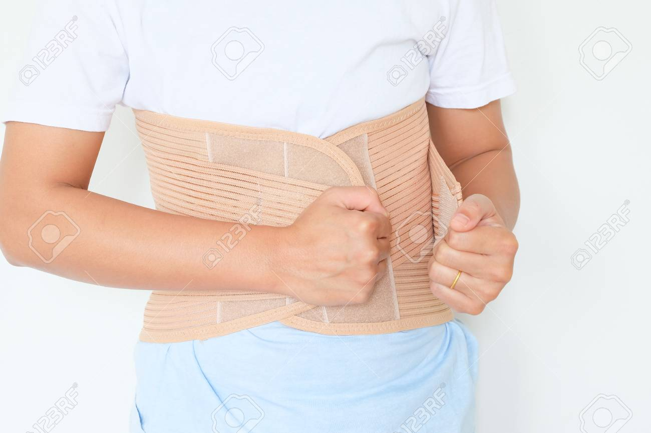 close up patient Lumbar spondylosis with LS support on white background. - 68390314