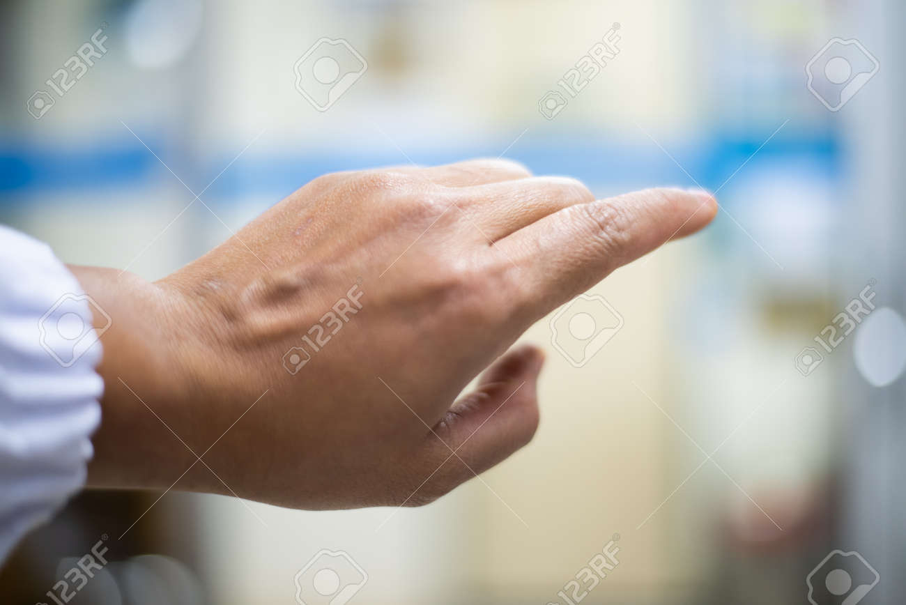 Hand scientis with out glove on blur background. - 167720652