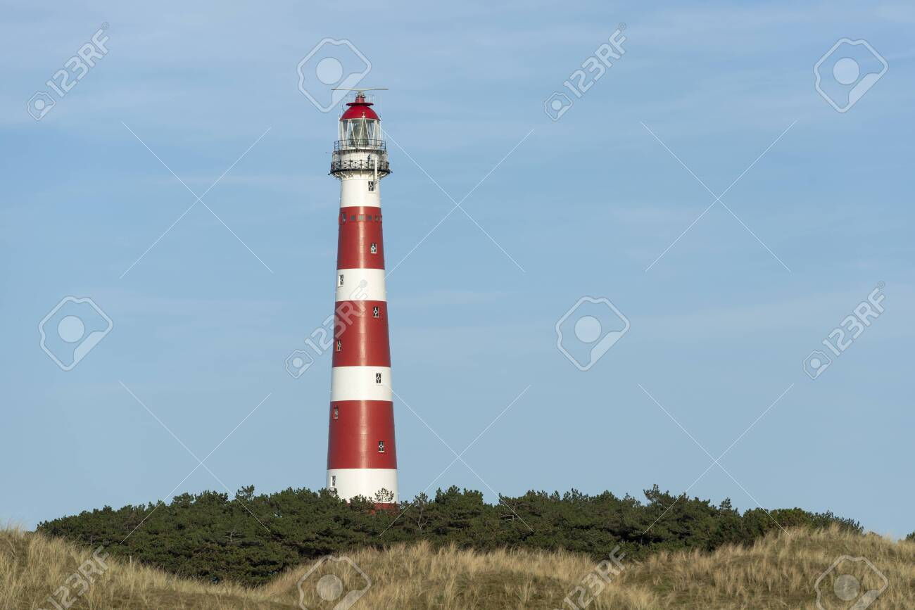The red and white striped lighthouse of the Wadden island of Ameland in the north of the Netherlands - 148904803