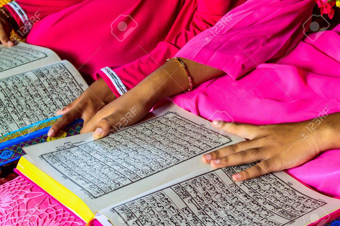 A Young Muslim Girl reading the Holy Quran Stock Photo - 19120466
