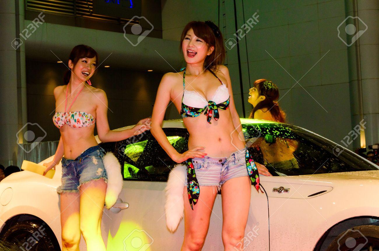 BANGKOK - JUNE 20   Show Beautiful bikini models wash a car at Bangkok International Auto Salon 2013 Exciting Modified Car Show on June 20, 2013 in Bangkok, Thailand  Stock Photo - 20449426