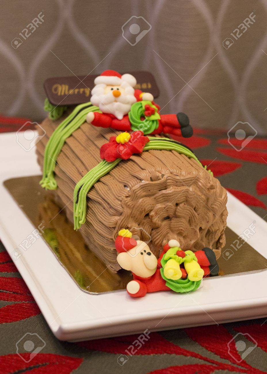 Christmas Yule Log Cake.Traditional Christmas Yule Log Cake Decorated With Santa Bear