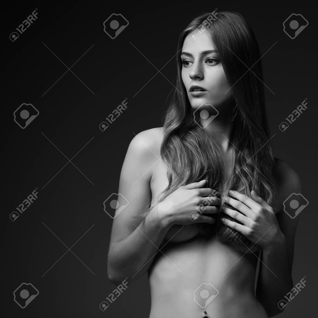 Black and white studio photo of elegant naked lady