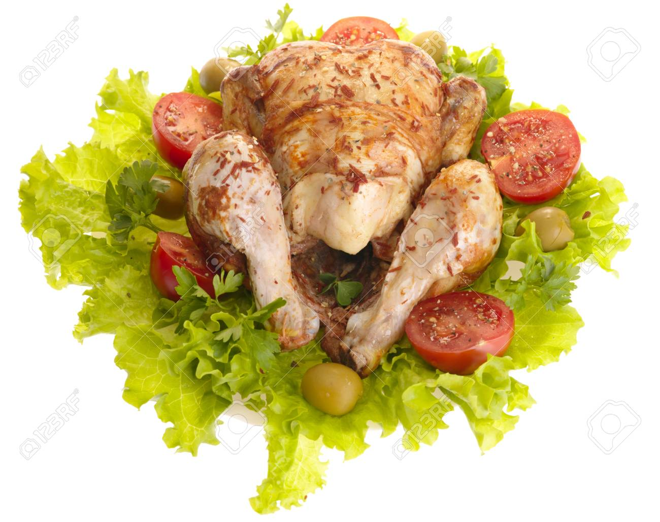 grilled chicken whole with vegetables on salad leafs Stock Photo - 4891310