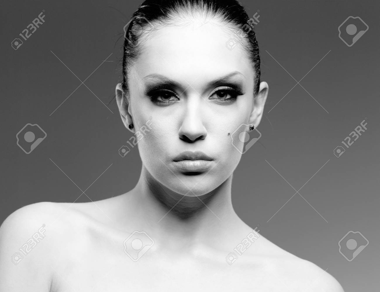 Makeup and glamour. Young attractive woman studio portrait. Stock Photo - 6561780