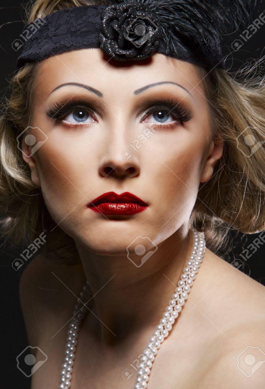 Woman's retro revival portrait. 30's of the XX century. Professional makeup Stock Photo - 8172555