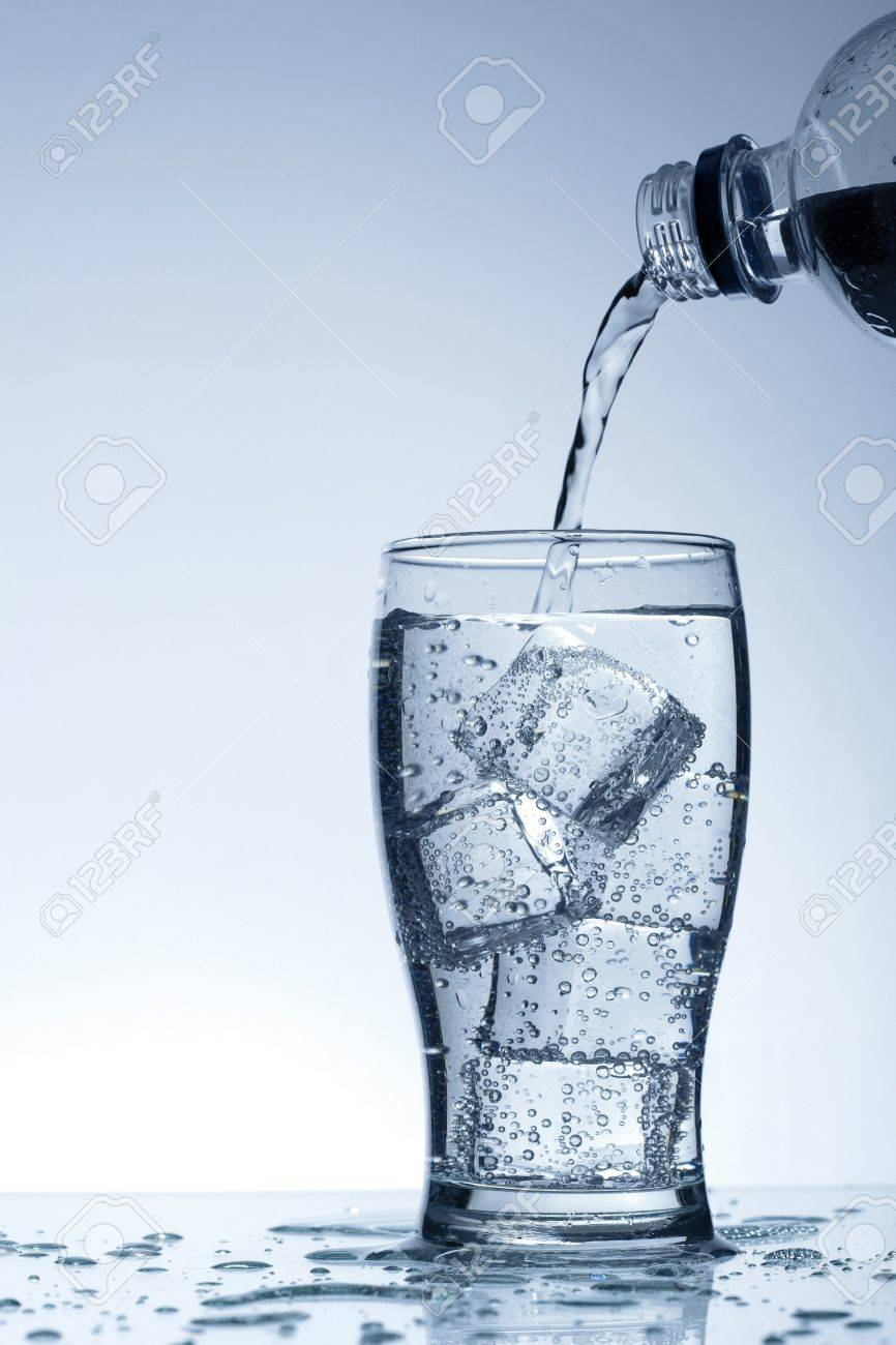 Cold purified water in the glass with bubbles and reflection on the wet background Stock Photo - 7325012