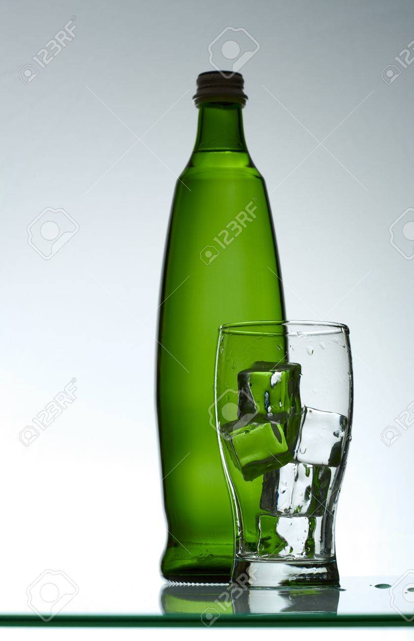 Purified mineral water on the wet glass desk with reflection Stock Photo - 7341483