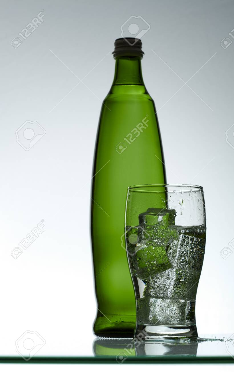 Purified mineral water on the wet glass desk with reflection Stock Photo - 7341496