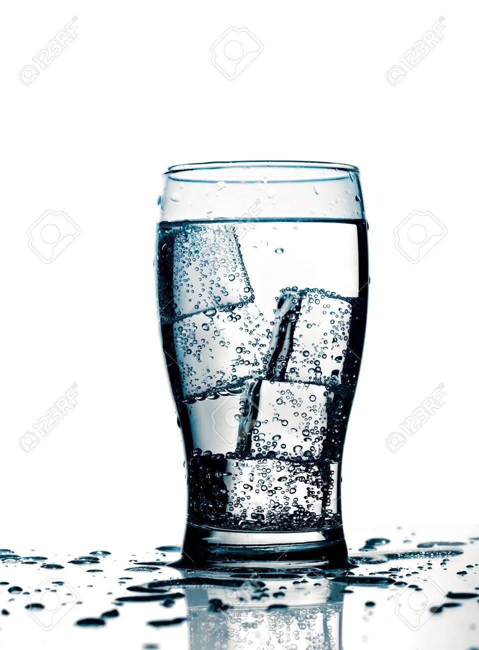 glass with cold purified water and ice, over white background Stock Photo - 9112722