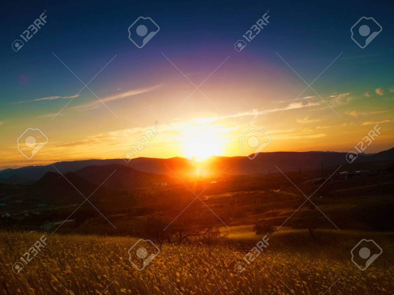 Dramatic sunset over valley. Natural seasonal landscape - 22510436