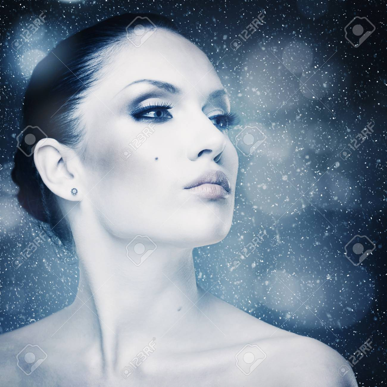 Winter freshness, abstract female portrait with falling snow as background Stock Photo - 24925429