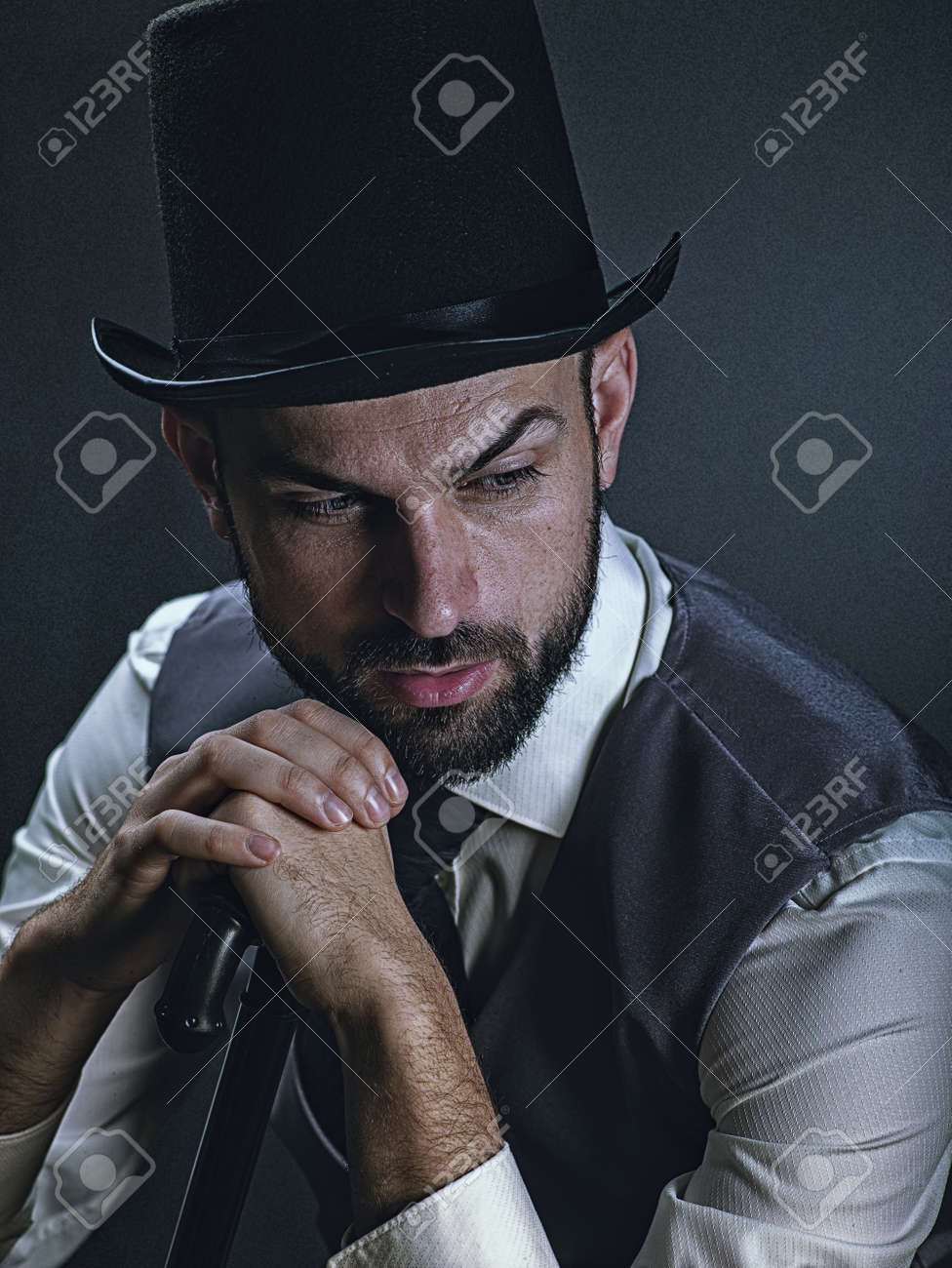 The gentleman. Dramatic male portrait with classic light and retro dress - 168857915
