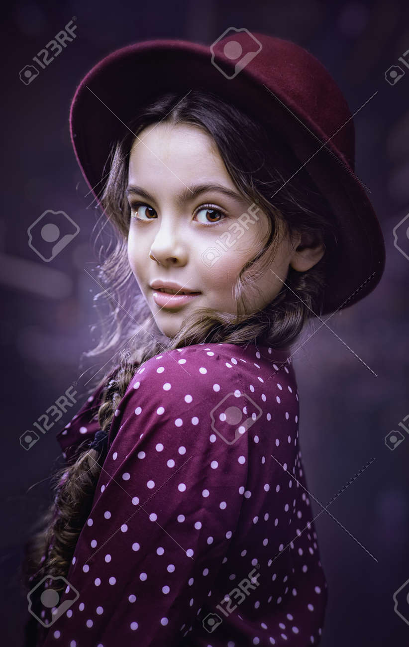 Urban female portrait. Beauty young girl turned around and looking at camera - 168857924