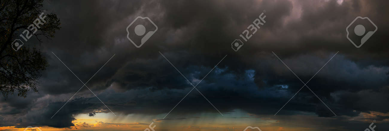 Last minutes before the storm. Dramatic skies under evening sea - 159256694