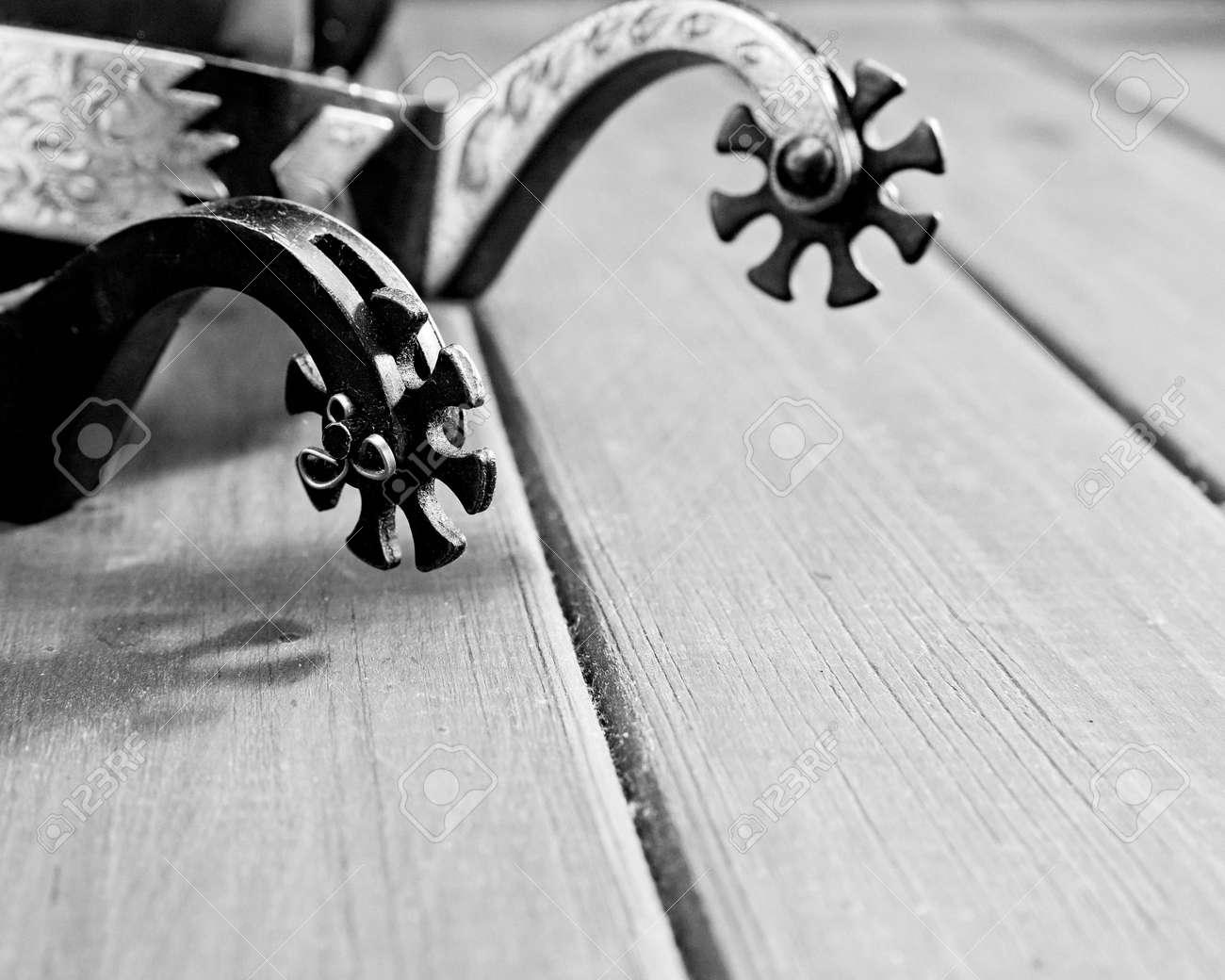 Retro still life. Spurs over vintage wooden desk - 159256857