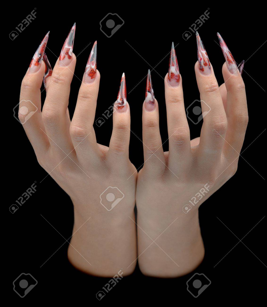 Closeup Of Hand Of Young Woman Long Nail-art Manicure On Nails ...