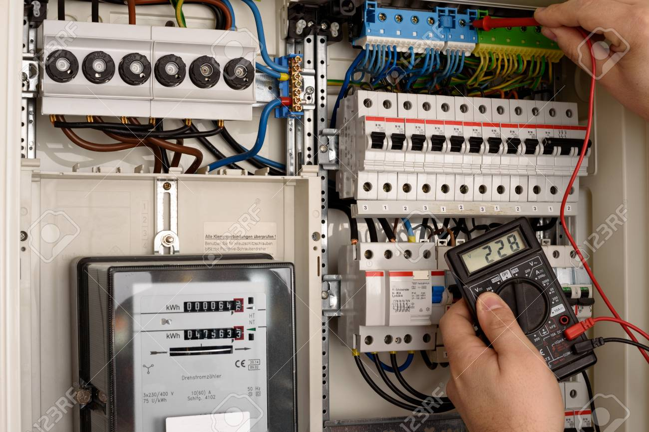 An Electrician Is Working On A Fuse Box Stock Photo Picture And Electrical 69419890