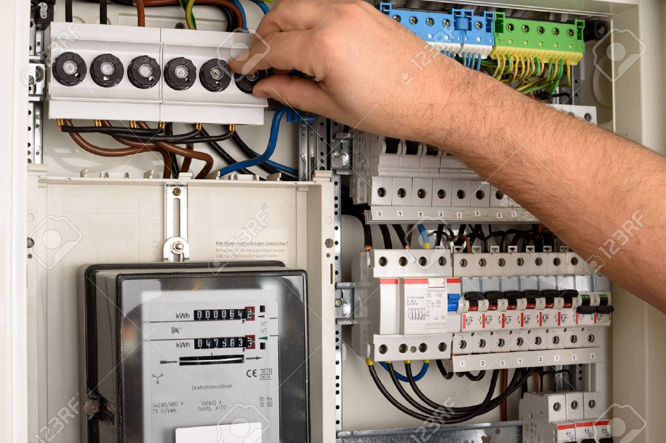 an electrician is working on a fuse box  electrician fuse box #11