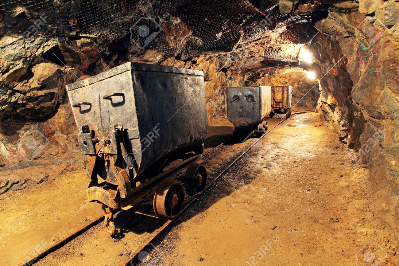Mining cart in silver, gold, copper mine - 38777507